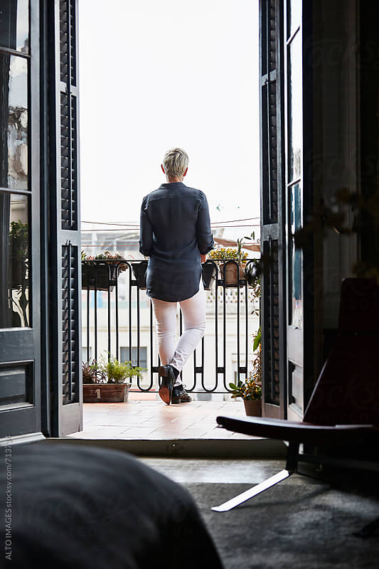 Senior Woman Standing On Balcony by ALTO IMAGES for Stocksy United