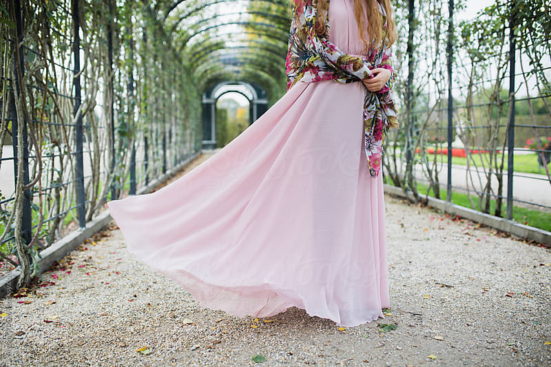 Young woman in a pink long dress by Jovana Rikalo for Stocksy United