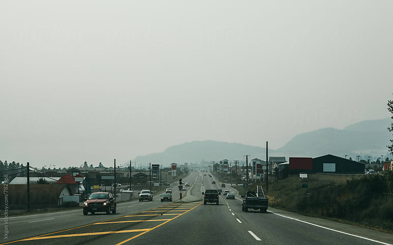 Washington Forest fire smoke drifiting across a highway in Canada by kkgas for Stocksy United