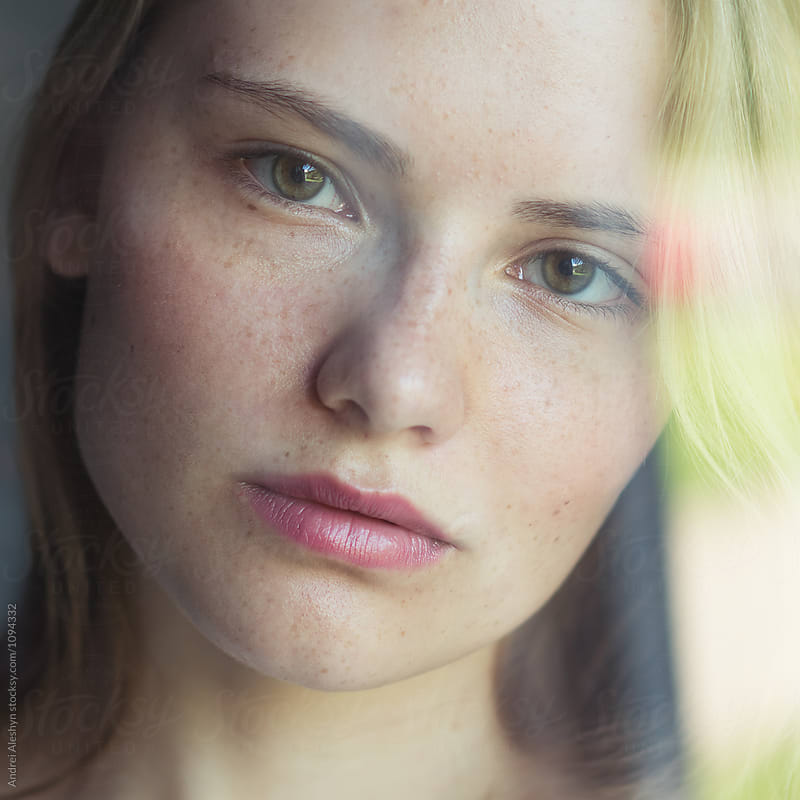 portrait of a beautiful young girl close-up by Andrei Aleshyn for Stocksy United