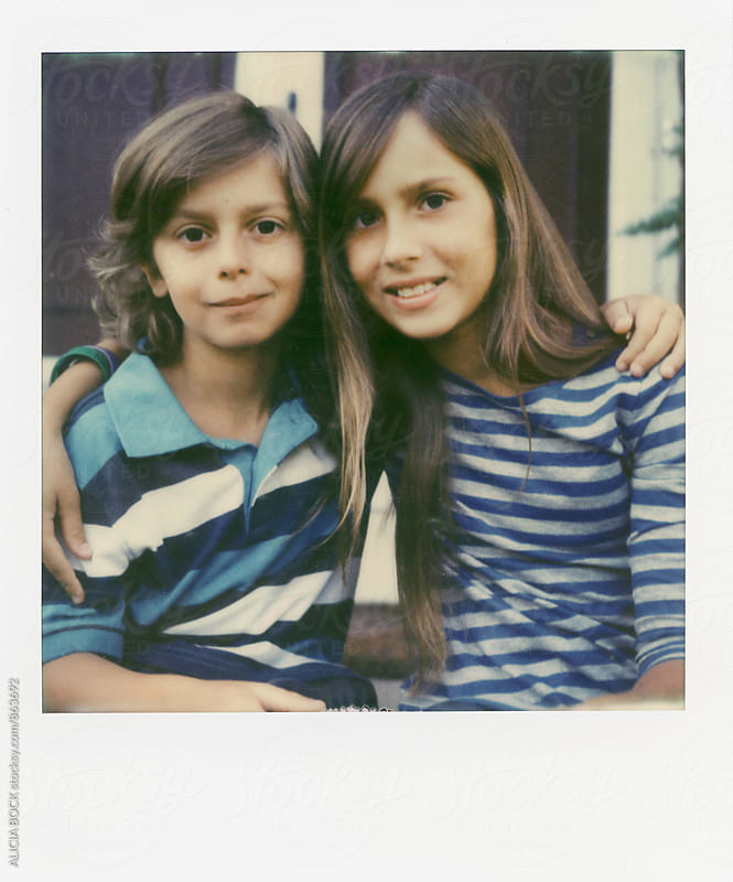 Polaroid Portrait Of A Brother And Sister Wearing Striped Shirts by ALICIA BOCK for Stocksy United