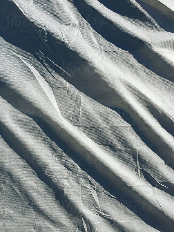 Grey protective fabric covering car, close up by Paul Edmondson for Stocksy United