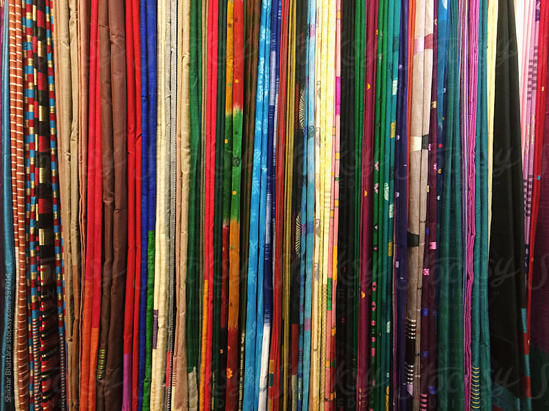 Background of colorful clothes at an South Asian clothing store. by Shikhar Bhattarai for Stocksy United