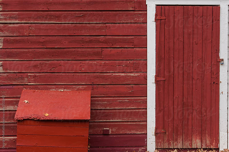 detail of a red barn by Deirdre Malfatto for Stocksy United
