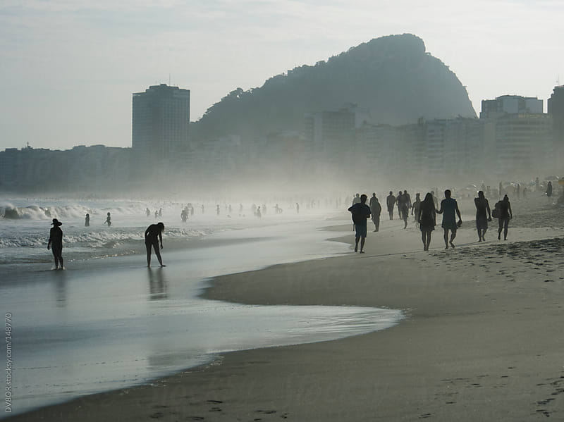 View on Copacabana Beach with Silhouetted people in Rio de Janeiro, Brazil  by DV8OR for Stocksy United