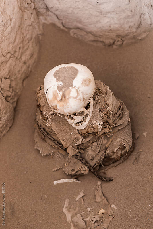 Mummified remains of a toddler at Chauchilla Peru by Ben Ryan for Stocksy United