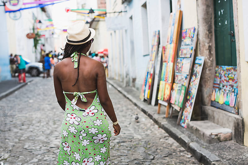 Brazil. Woman walking outdoor by Mauro Grigollo for Stocksy United