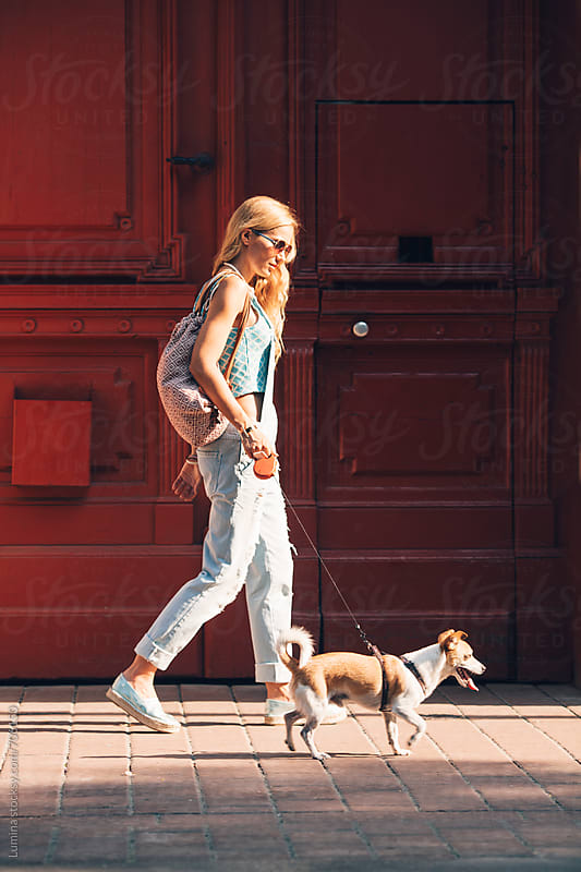 Woman Walking Her Dog by Lumina for Stocksy United