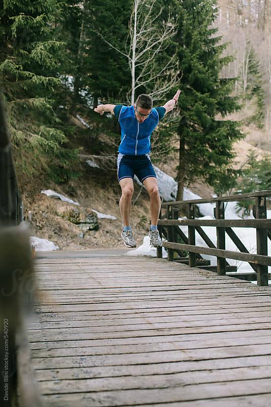 Caucasian man training outdoors by Davide Illini for Stocksy United