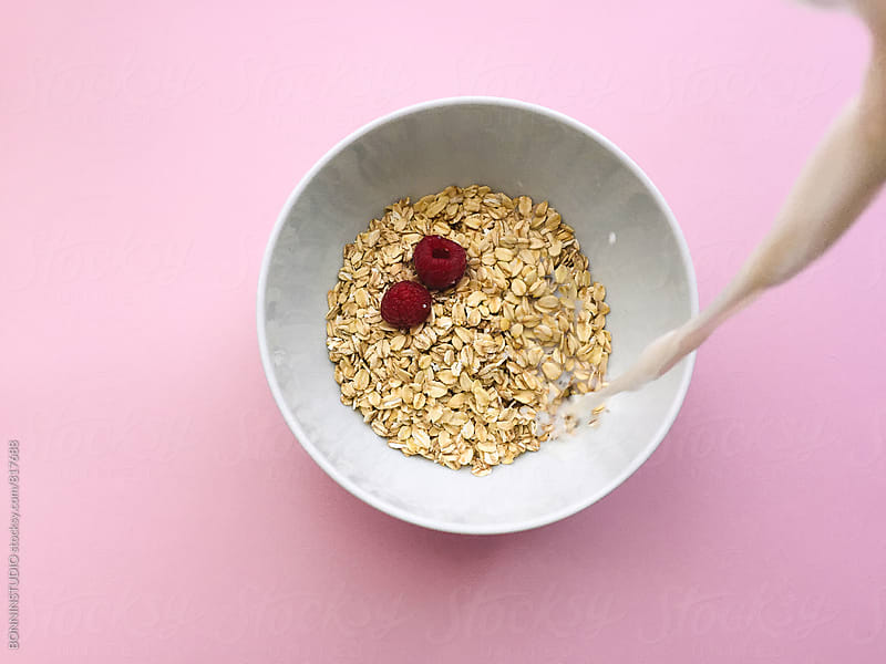 Organic oat breakfast in a bowl. by BONNINSTUDIO for Stocksy United
