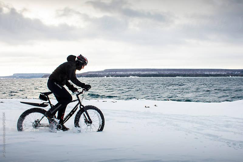 Extreme Sport Winter Mountain Biking with Fat Bike In Snow by JP Danko for Stocksy United