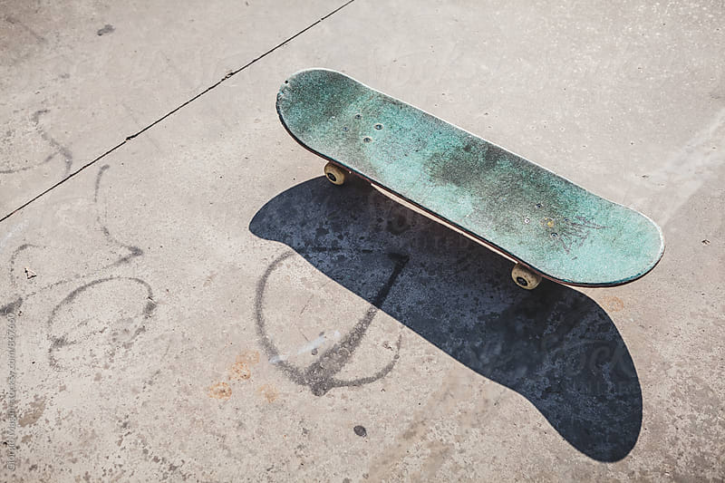 Worn Skateboard on Concrete Paving