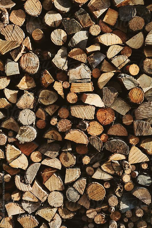 Stacked chopped wood by Borislav Zhuykov for Stocksy United