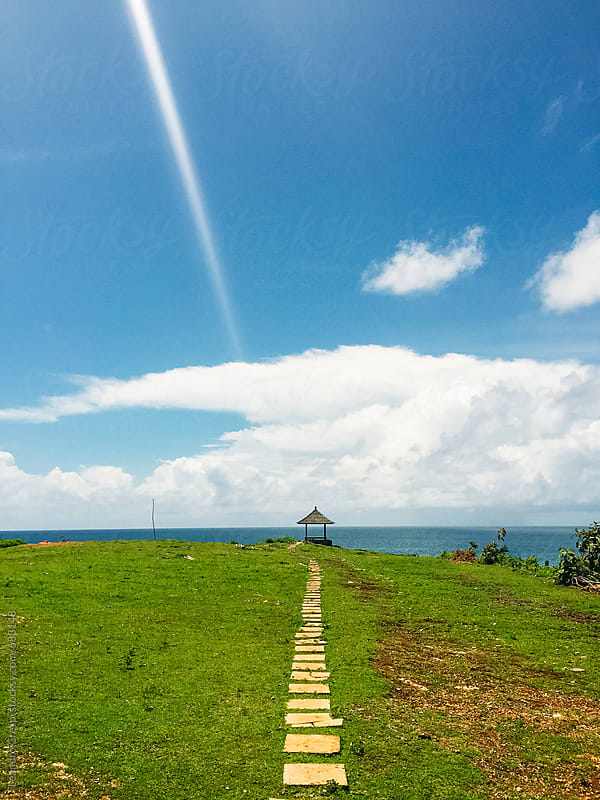 A path to a gazebo on the coast on a sunny day by Leandro Crespi for Stocksy United