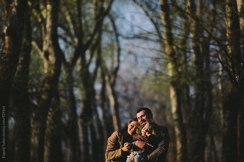Family injoy the sun under the poplar trees by Evgenij Yulkin for Stocksy United