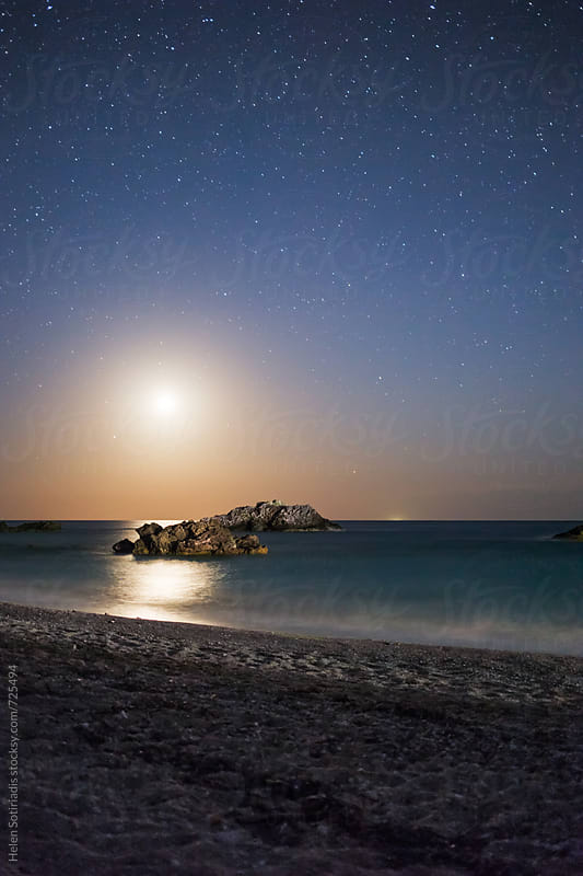 The Moon Sets at a Sandy Beach by Helen Sotiriadis for Stocksy United