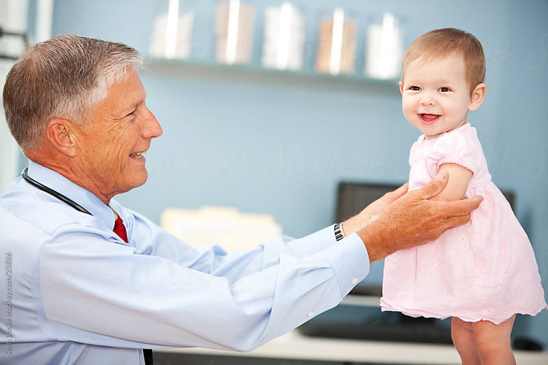 Exam Room: Cheerful Baby at Doctor's Office by Sean Locke for Stocksy United