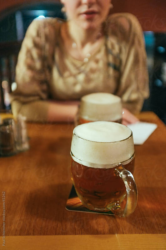 Having a midnight beer with a girlfriend by Paul Schlemmer for Stocksy United