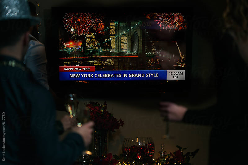 NYE: Friends Watching Television At Midnight by Sean Locke for Stocksy United