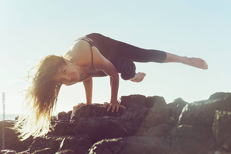 Pretty Woman in Arm Balance Yoga Pose by VISUALSPECTRUM for Stocksy United