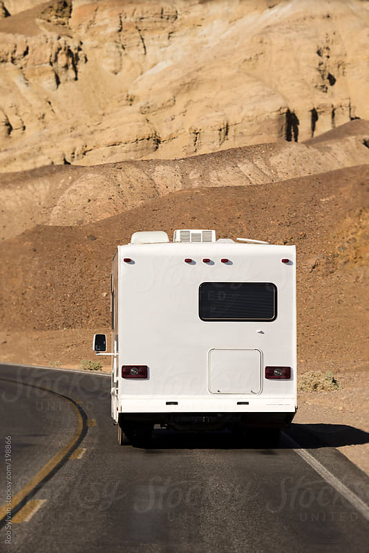 Recreation Vehicle on the Road by Rob Sylvan for Stocksy United