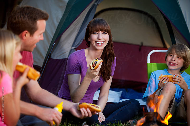 Camping: Mother Having a Great Time with Family by Sean Locke for Stocksy United