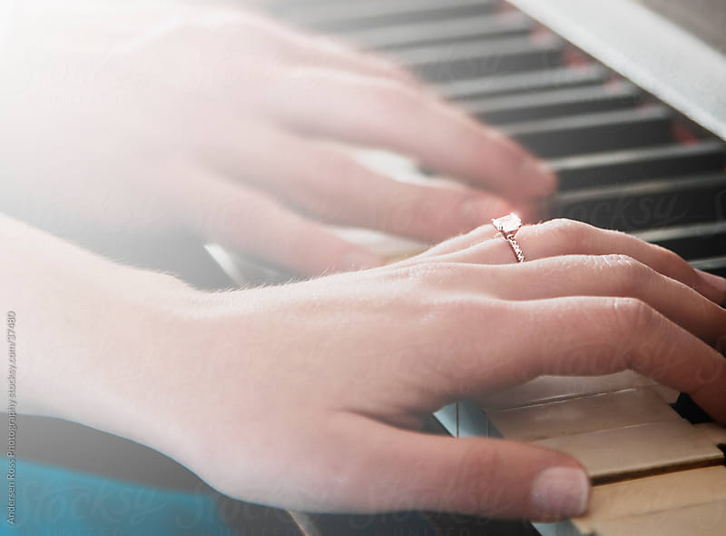 Close-up of couple's hands playing piano by Andersen Ross Photography for Stocksy United