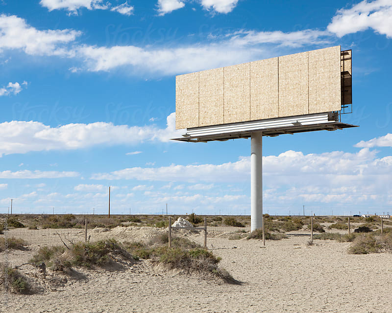 Empty billboard in desert, by Paul Edmondson for Stocksy United