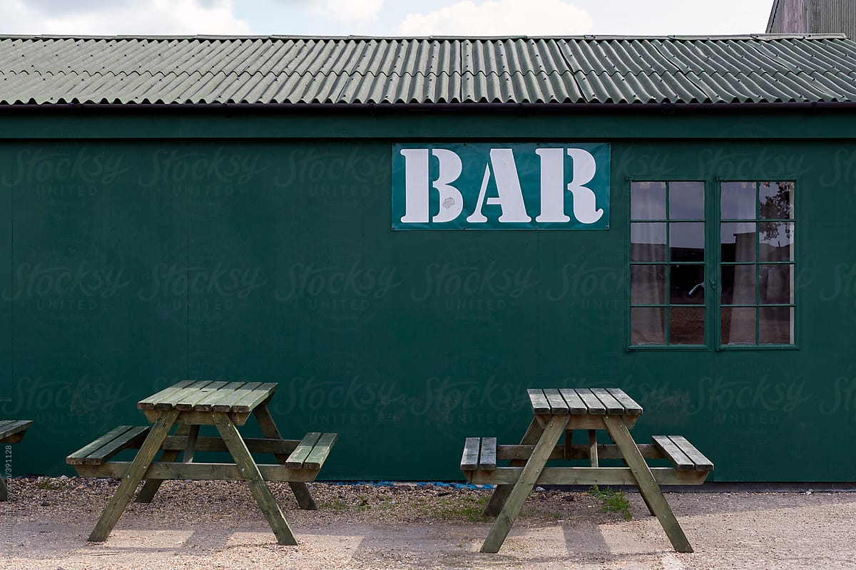 Stock Photo - Bar Sign On The Side Of A Temporary Building With Outside  Seating Area