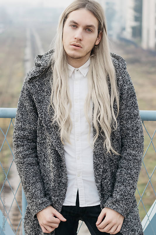 Handsome male model with long blond hair by Branislava Živić for Stocksy United