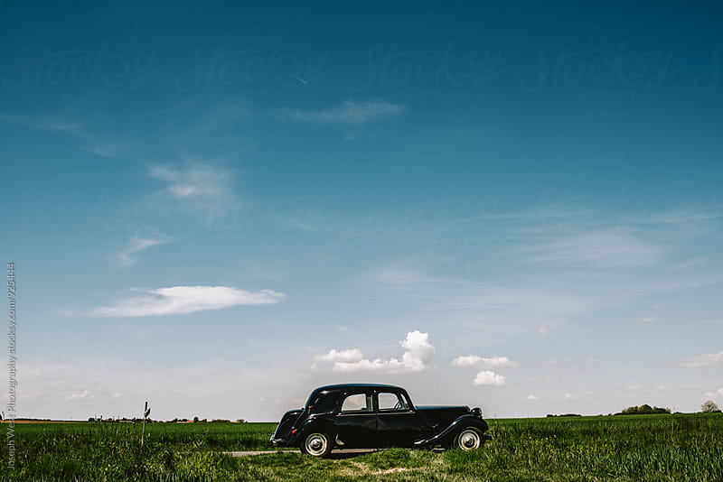 A black cab parked in the English countryside by Joseph West Photography for Stocksy United
