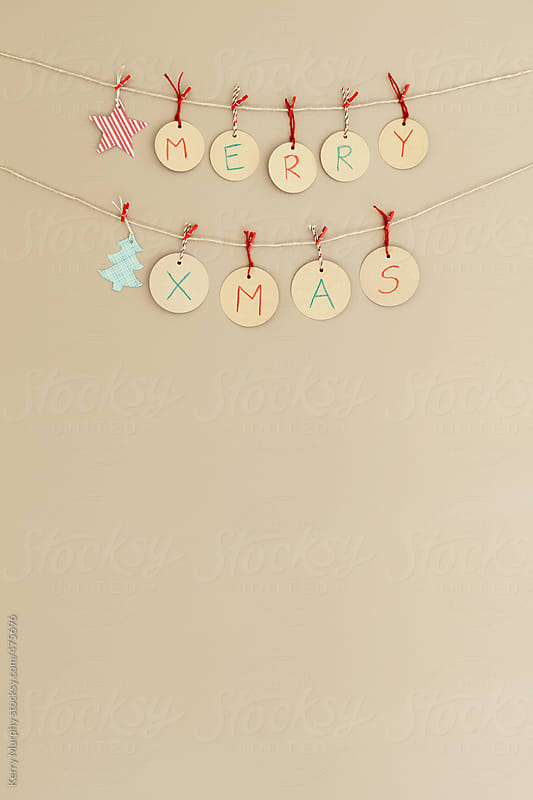 Merry Xmas spelled out on handmade banner by Kerry Murphy for Stocksy United