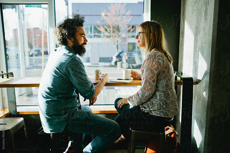 Man and Woman meeting over Coffee by Kristine Weilert for Stocksy United