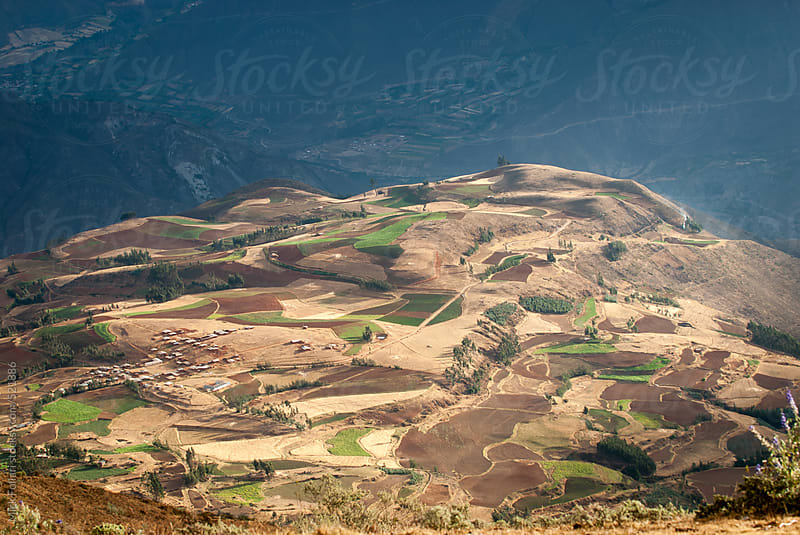 Chacras (small farms) sitting on a small mesa seen from above  by Mick Follari for Stocksy United