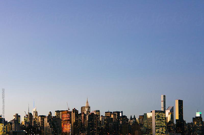 Manhattan skyline at twilight. New York City. by Kristin Duvall for Stocksy United