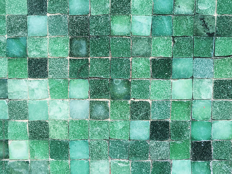 green tiles mosaic by Guille Faingold for Stocksy United