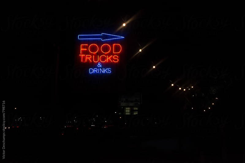 Foodtrucks and Drinks Neon Sign at Night by Victor Deschamps for Stocksy United
