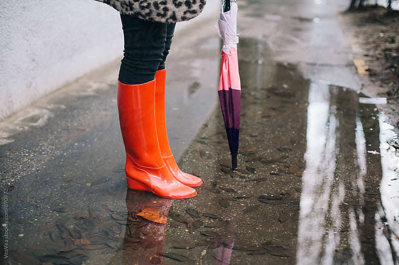 Woman in red gumboots outdoors by Marija Mandic for Stocksy United