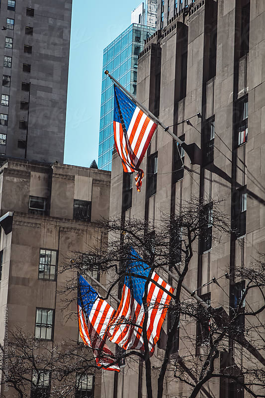 New York streets, the American flags, freedom by Igor Madjinca for Stocksy United