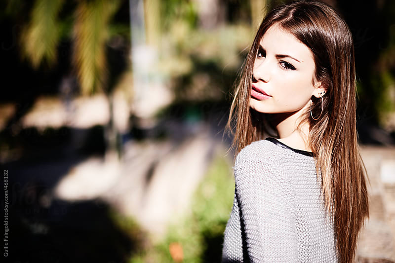 Beautiful female posing in a park by Guille Faingold for Stocksy United