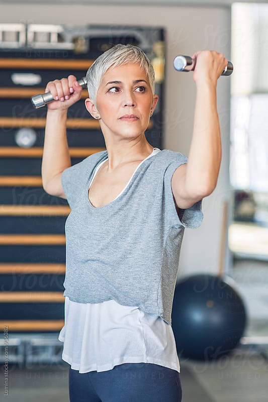 Woman Lifting Weights in the Gym by Lumina for Stocksy United