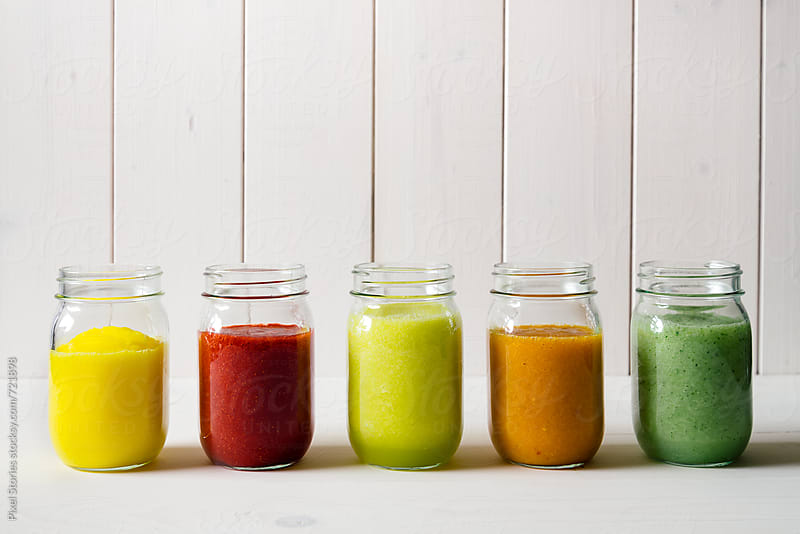 Fruit smoothies in jars by Pixel Stories for Stocksy United