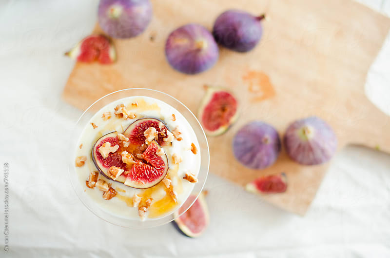 yoghurt with fresh figs, walnuts and honey by Canan Czemmel for Stocksy United