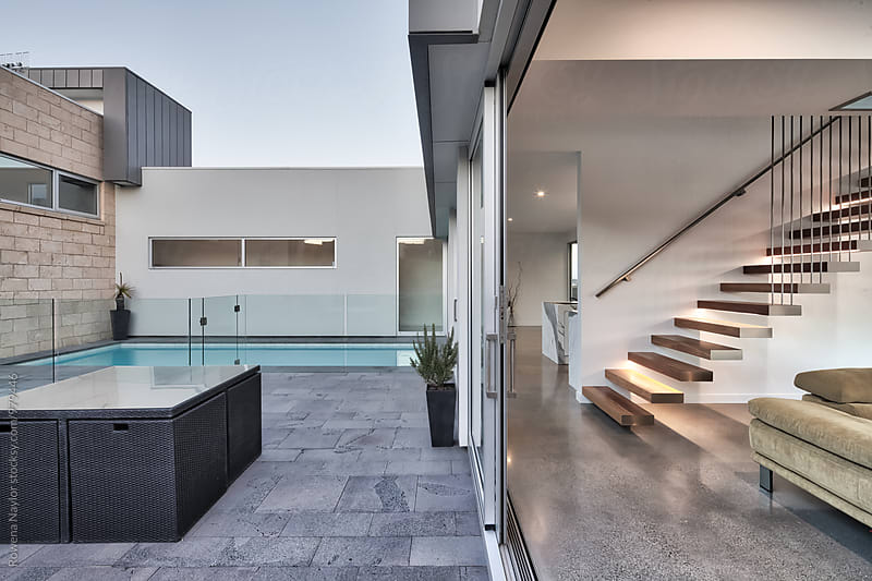 Modern home with pool by Rowena Naylor for Stocksy United