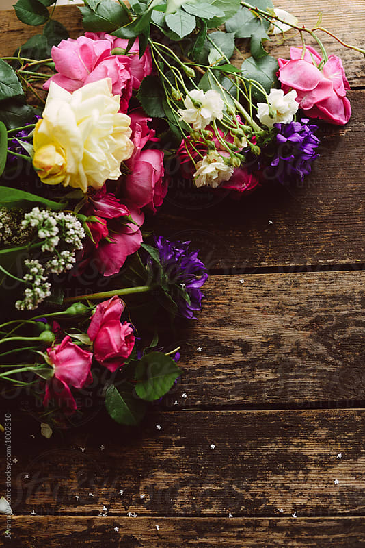 Fresh bouquet at the wodden table by Jovana Vukotic for Stocksy United