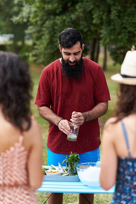 Bearded barman preparing mojito drink by Guille Faingold for Stocksy United