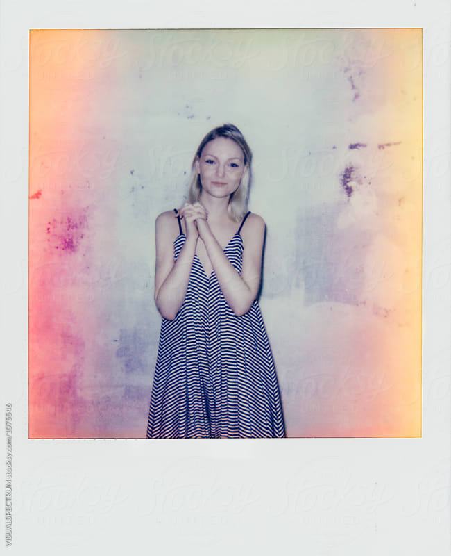 Polaroid of Young Smiling Blond Woman Wearing Summer Dress by VISUALSPECTRUM for Stocksy United