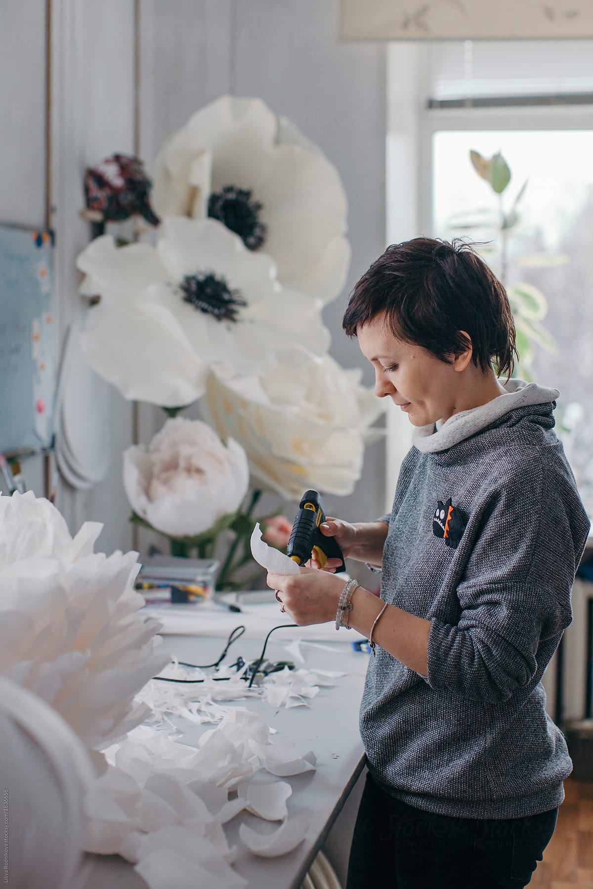 Artist Creating Big Paper Flowers In Her Workshop By Liliya