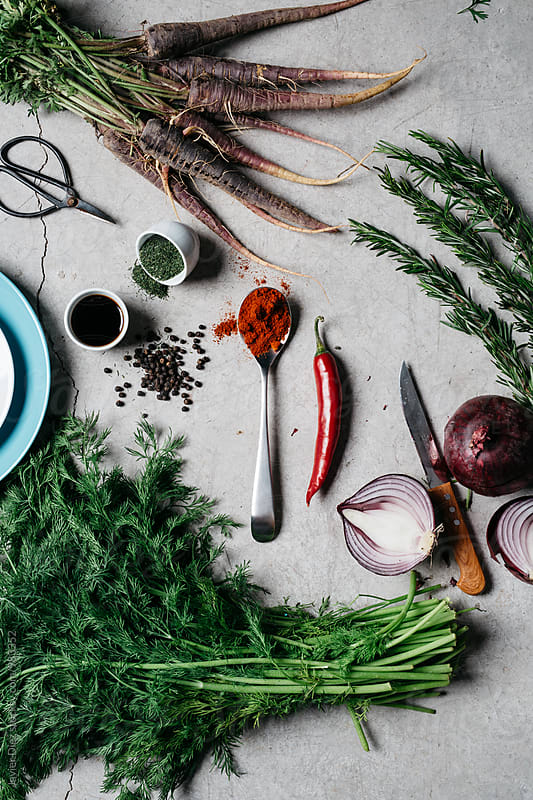 View on fresh food ingredients on grey table by Javier Díez for Stocksy United