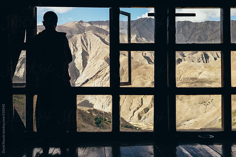 Lingshed monk looking through the window by David Navais for Stocksy United